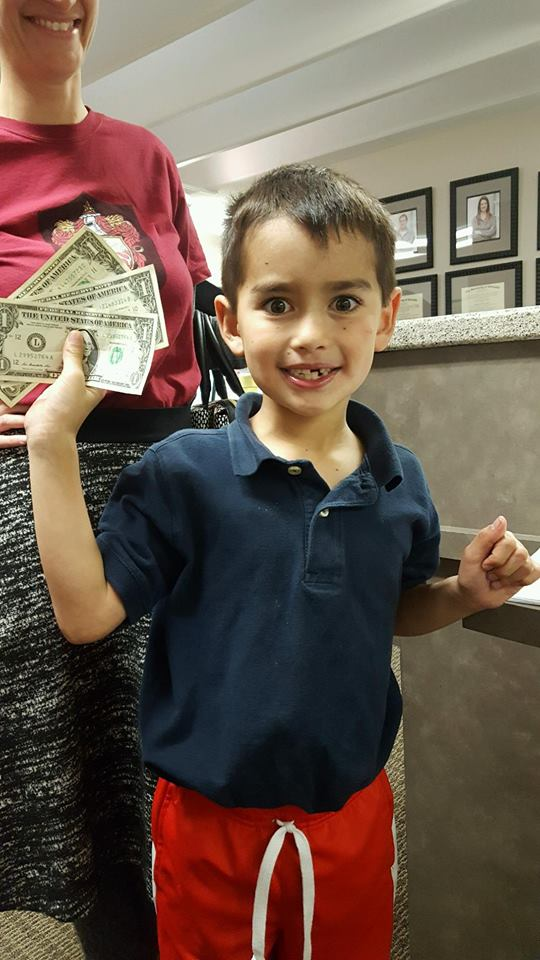A child participating in Operation Gratitude Candy Buy Back at Lydiatt and Duru Family Dentistry.